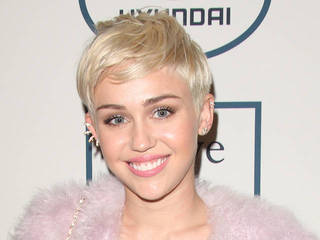 Miley Cyrus slams Katy Perry over kissing...
