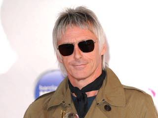 Paul Weller wins damages over family photos