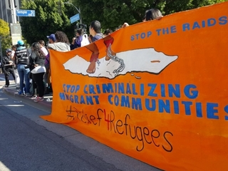 Protests over deportation raids close LA street
