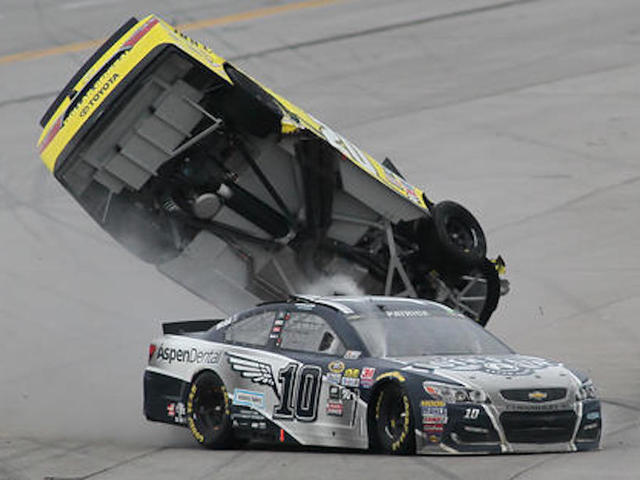 car flips after Danica Patrick (10) crashed into him during the NASCAR ...