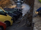 Sinkhole swallows over a dozen cars in Italy