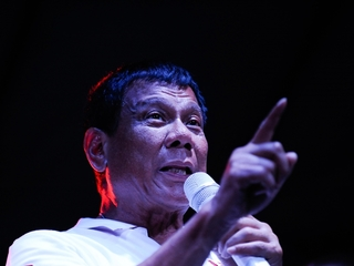 Philippine leader publicly accuses officials