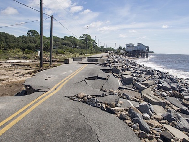 Hermine lingers off shore continuing its unsafe storm surges