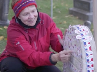 Voters put stickers on Susan B. Anthony's grave