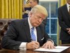 Trump signs memorandum leaving TPP