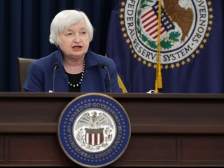 Fed raises rates, says economy is strengthening