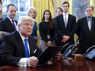 13 states file to support Trump's travel ban