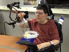 Device gives paralyzed man use of his hands