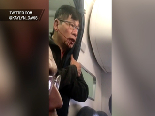 Man dragged off United flight plans to sue