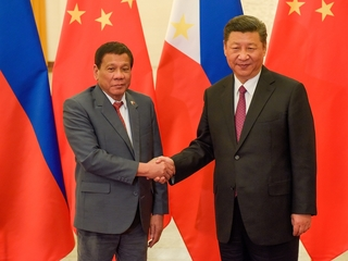 Philippines and China clash over disputed waters