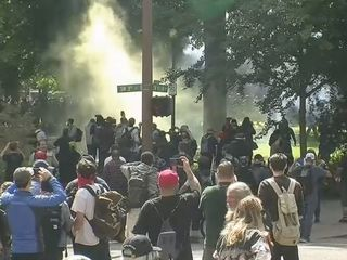 14 arrested after Portland protests turn violent
