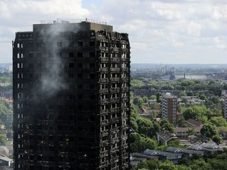 May launches inquiry into Grenfell Tower fire