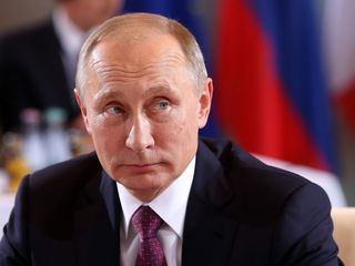Putin says sanctions won't lead to 'collapse'