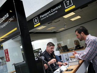 Federal judge loosens part of travel ban