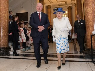 Canadian official touches queen, breaks protocol