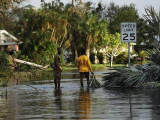 How can cities protect against hurricanes?