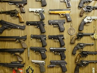 Law bars federal funds from researching guns