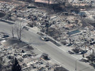 California wildfire losses top over $1 billion