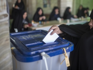 Iran elections swing in Rouhani's favor