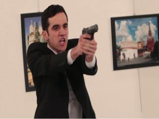 AP photographer captures attack on ambassador