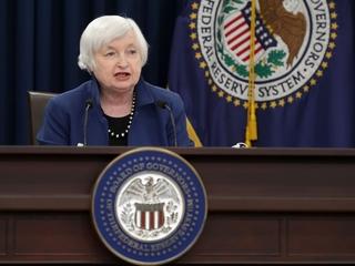 Fed raises rates, says economy is strengthening