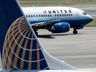 Flight evacuated after blown tire in Denver