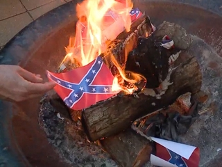 Art museum holds confederate flag burning