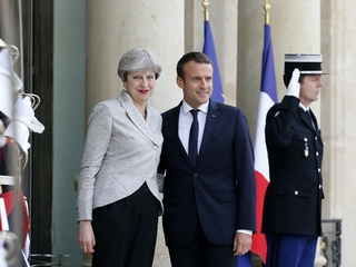 May, Macron meet in Paris, talk terrorism