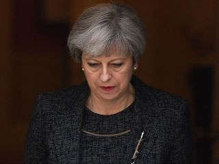 UK PM criticized for her response to tower fire