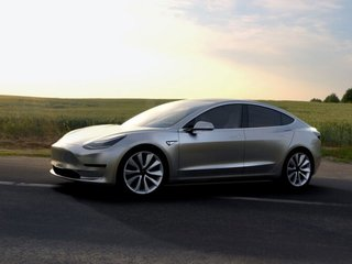 Tesla to deliver first Model 3 vehicles in July