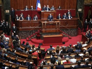 Macron proposes sweeping changes to Parliament