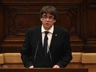 Catalan president sort of declares independence
