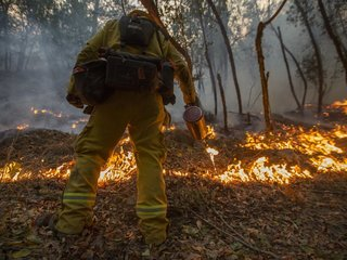 Firefighters make slow progress in Calif. fires