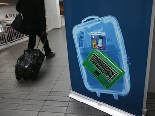 Authorities weigh ban on laptops in checked bags