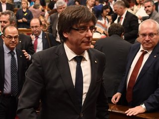 Catalania's Puigdemont surrenders to authorities