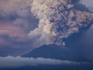 Bali's airport reopens as volcano keeps erupting