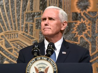 Pence delaying Israel trip for tax vote