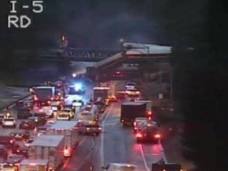 Amtrak Train Derails Over Highway In...