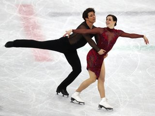 Olympic skaters perform to music with vocals