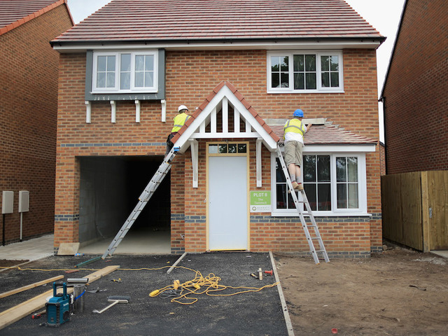 MIDDLEWICH, ENGLAND   MAY 20: Construction Workers Build New Houses On A  Housing Development On May 20, 2014 In Middlewich, England.