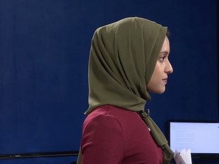 A TV reporter makes history with her hijab