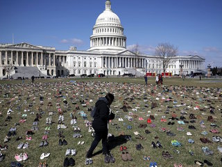 Activists place 1,000s of shoes on Capitol lawn