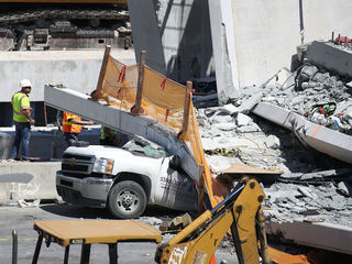 PHOTOS: Bridge collapse near FIU crushes cars