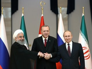 Russia, Iran, Turkey talk ending Syria conflict