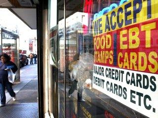 Trump signs order to toughen welfare criteria