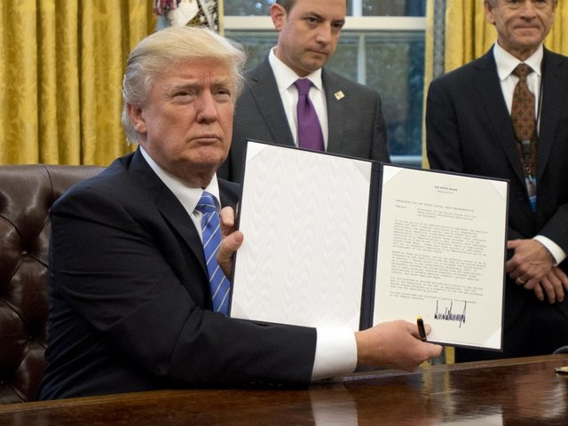 Trump signs executive order on work requirements for poor people receiving aid