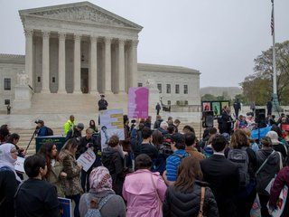 US Supreme Court hears travel ban case