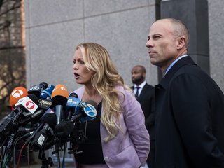 Judge delays Daniels' lawsuit against Cohen