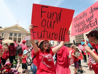 Arizona gov. signs plan to give teachers raises