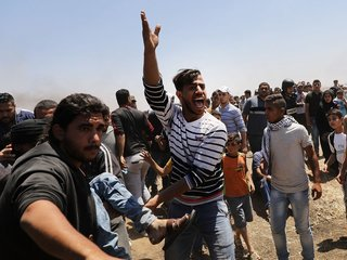Protests at Gaza border leave dozens dead
